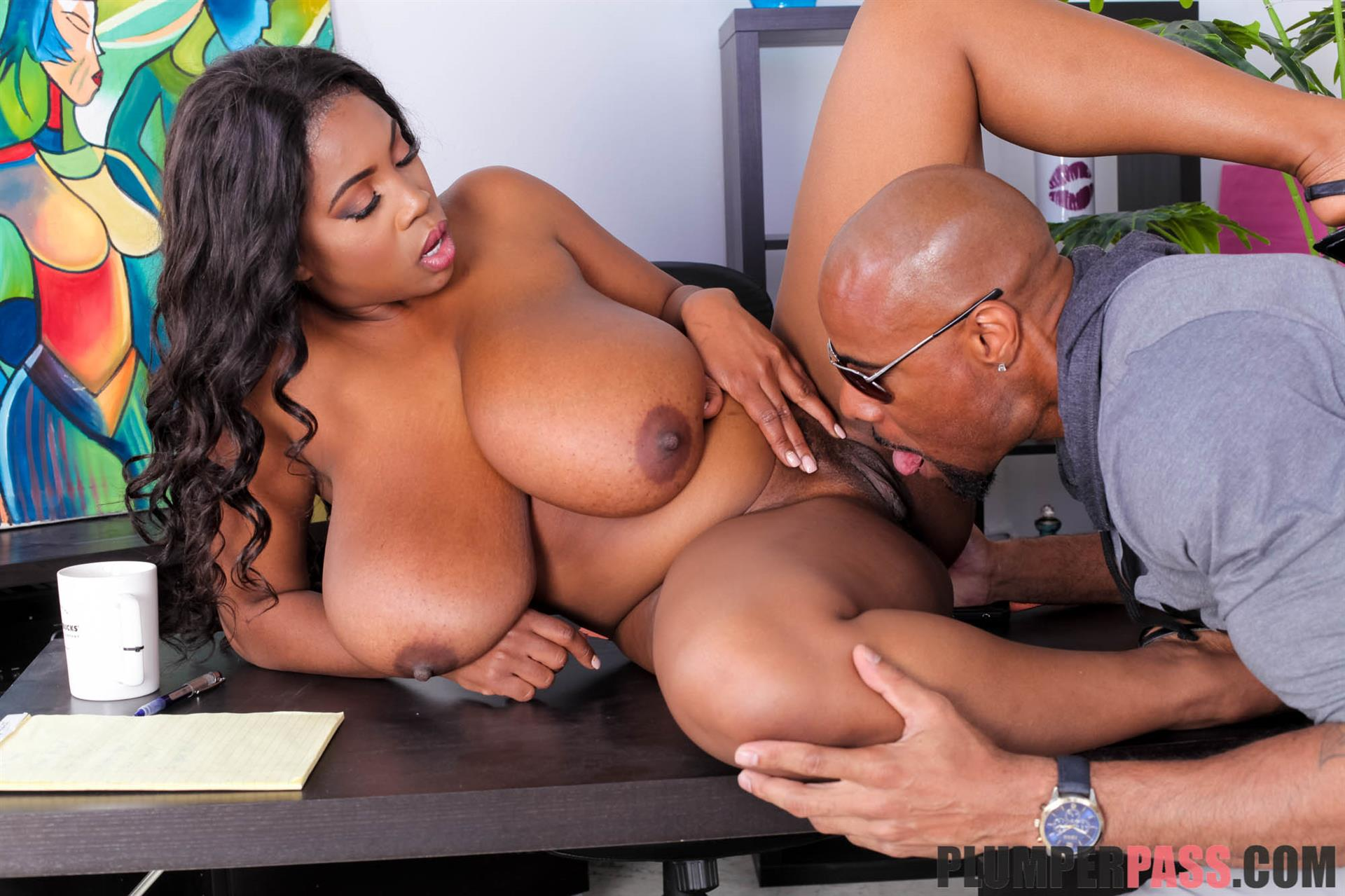 Black chick with big tits fucks a white man with tattoo